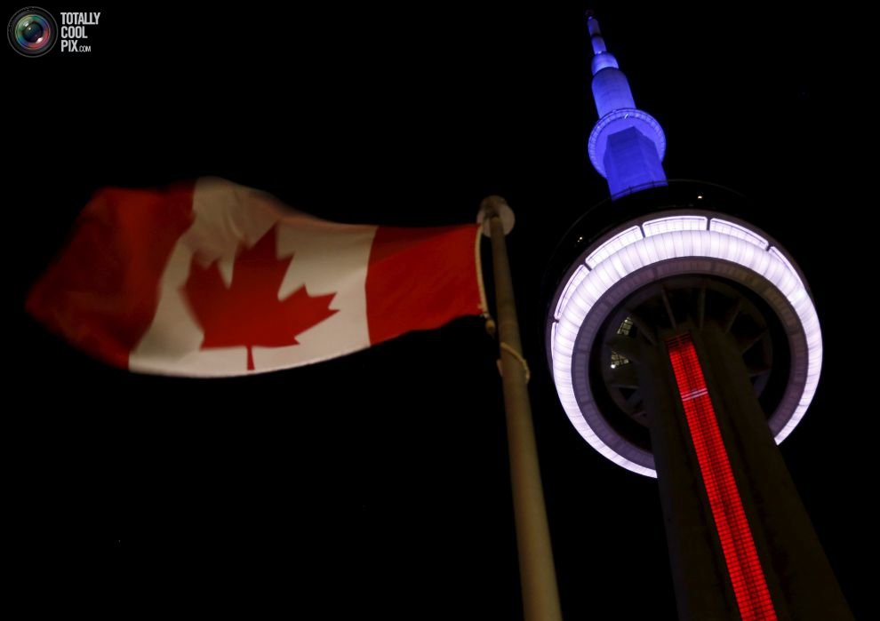 Toronto's landmark CN Tower is lit blue, white and red