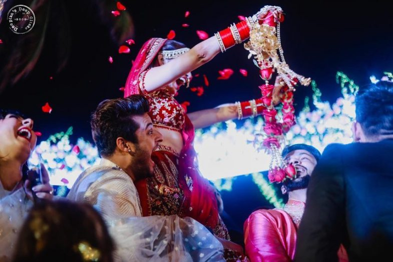 Prince Narula and Yuvika Chaudhary during jaimala, fun moment.